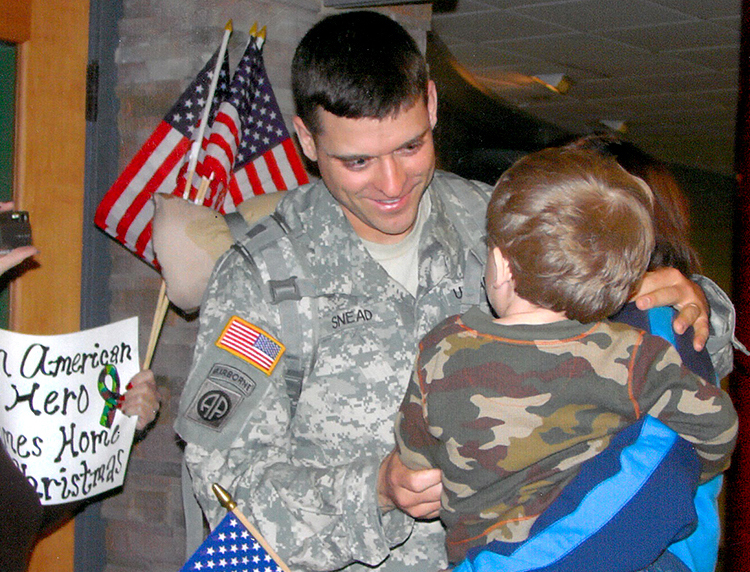 Matt Snead embraces his son Jackson after returning from Iraq in 2008.